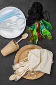 Plastic and cardboard disposable tableware for takeaway food. Plastic and eco concept.