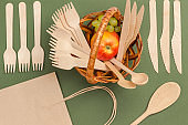Disposable cardboard dishes. Wooden forks and spoons.