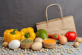 set of products for healthy eating. Paper bag with walnuts, chickpeas, beans, lentils