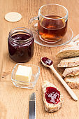 Sandwiches with jam. Wooden spoon and jam jar