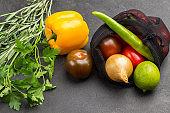Colored vegetables on black background.