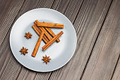 Cinnamon sticks and star anise in gray ceramic plate