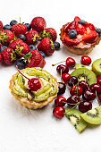Tart decorated with fresh berries. Strawberry and blueberries, Kiwi and red cherry