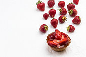 Tarts with berries. Strawberry on white background.
