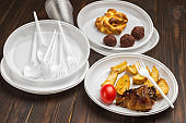 Food in Disposable white plastic tableware.