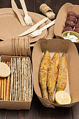 Picnic food in Eco-friendly cardboard disposable dishes.