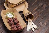 Falafel in cardboard bowl. Takeaway food in ecological packaging.
