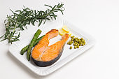 Grilled salmon green peas, lemon sprig of rosemary