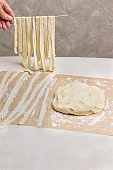 Rolled dough, sliced into strips.