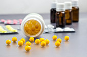 Vitamins, pills to treat colds. Glass Bottle with medicines. Cold remedies.