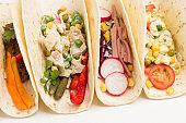 Vegan tortilla wraps withvegetarian salad.