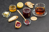 Tea drinking. Jar of honey, bread and biscuits.