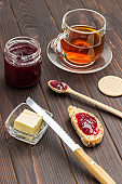 Butter and knife. Jam sandwich. Cup of tea and jam.