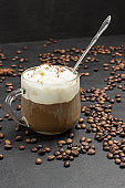 Ice cream and Glass with coffee. Coffee beans scattered on table.
