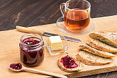 Sandwiches with jam. Wooden spoon and jam jar.