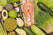 Food sources of omega 3 and omega 6 on black background.