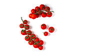 Fresh cherry tomatoes on branch isolated on white background.