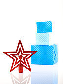 Red star in front of blue giftboxes