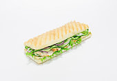 Gourmet panini with chicken breast, cucumber and onions. Top view. White background. Healthy eating concept.