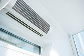 Large household air conditioning in a bright room. Device for adjusting the indoor climate. Copy space