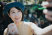 Beautiful Asian woman enjoy drinking cola at Chatuchak Weekend Market