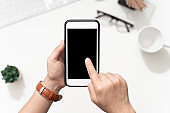 Top view image of woman' s hands holding smart phone and touch screen on blank screen mobile for mockup
