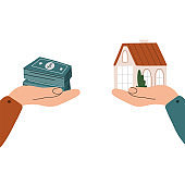 Hands with a house and banknotes