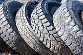 Pile of old truck tires on a junkyard - stock photo