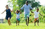 Family running in summer park