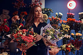 Portrait of beautiful florist with flowers