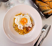 Spanish fried egg with fries and jamon