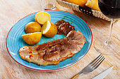Fried pork on bone with boiled potatoes in their skins