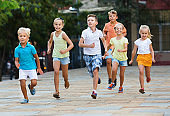 Group of  children running outdoors in city street
