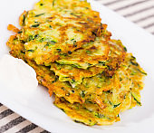 Fritters of courgettes with sour cream