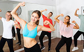 Female coach training dance with teenagers