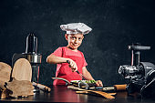 Portrait of cute little chef with vegetable dish