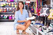 Portrait of fine woman purchasing pet bowls