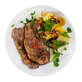 Pork chops with boiled potato, fried onion and parsley