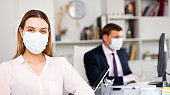 Young business woman in medical face mask