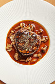 Filet mignon served with mushrooms top view