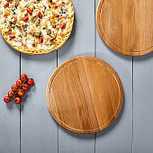 Pizzas on wooden boards top view