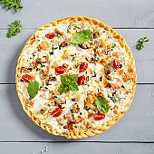 Seafood pizza on wooden board