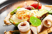 Grilled squid with avocado and egg