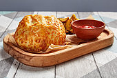 Roasted round cheese loaf and fried potatoes