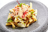 Pasta with crab, zucchini and truffle cheese