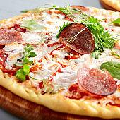Prosciutto Funghi pizza on wooden board