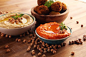 Traditional homemade hummus, falafel and chickpea on rustic table. Jewish Cuisine.