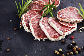 Salami truffle. The saltufo is a piece of salami mixed with summer truffle and parmesan on table