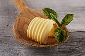 butter swirls. margarine or spread, fatty natural dairy product. High-calorie food for cooking and dairy eating