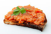 Traditional food from Romania concept with vegetable spread (Romanian: zacusca) on one single slice of toast bread isolated on white background